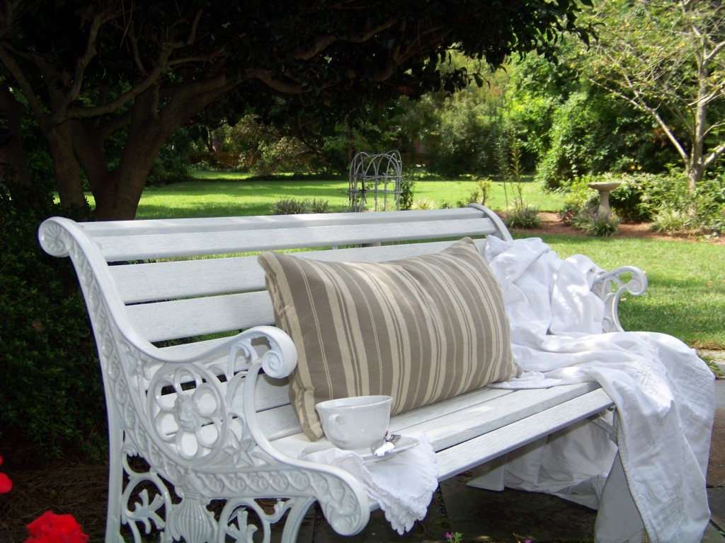 painted garden bench with teacup