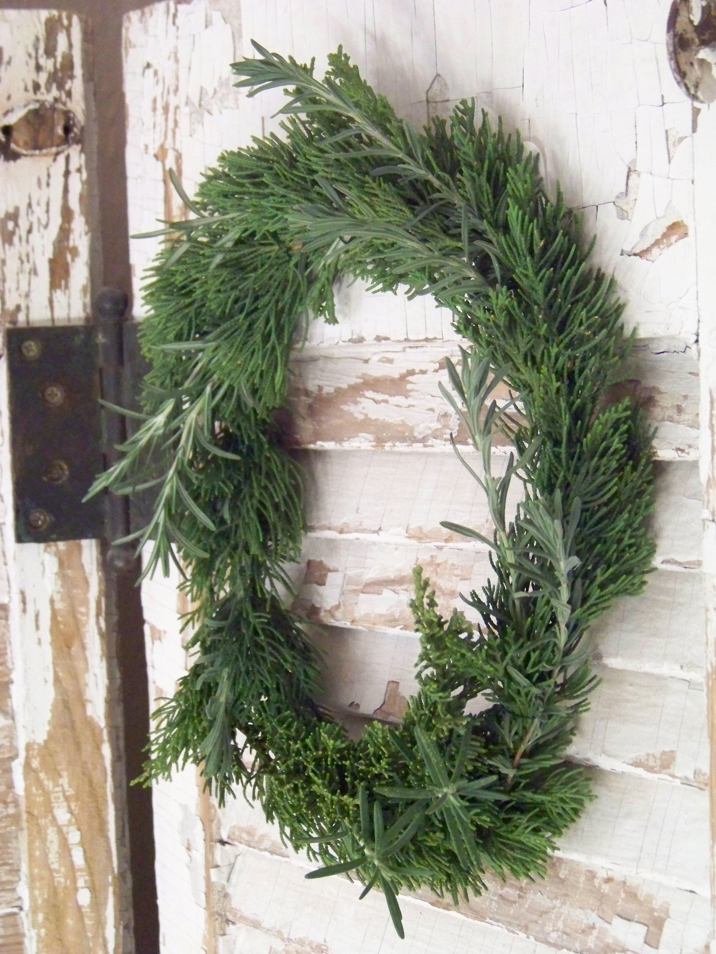 fresh wreath of evergreen, rosemary, and lavender