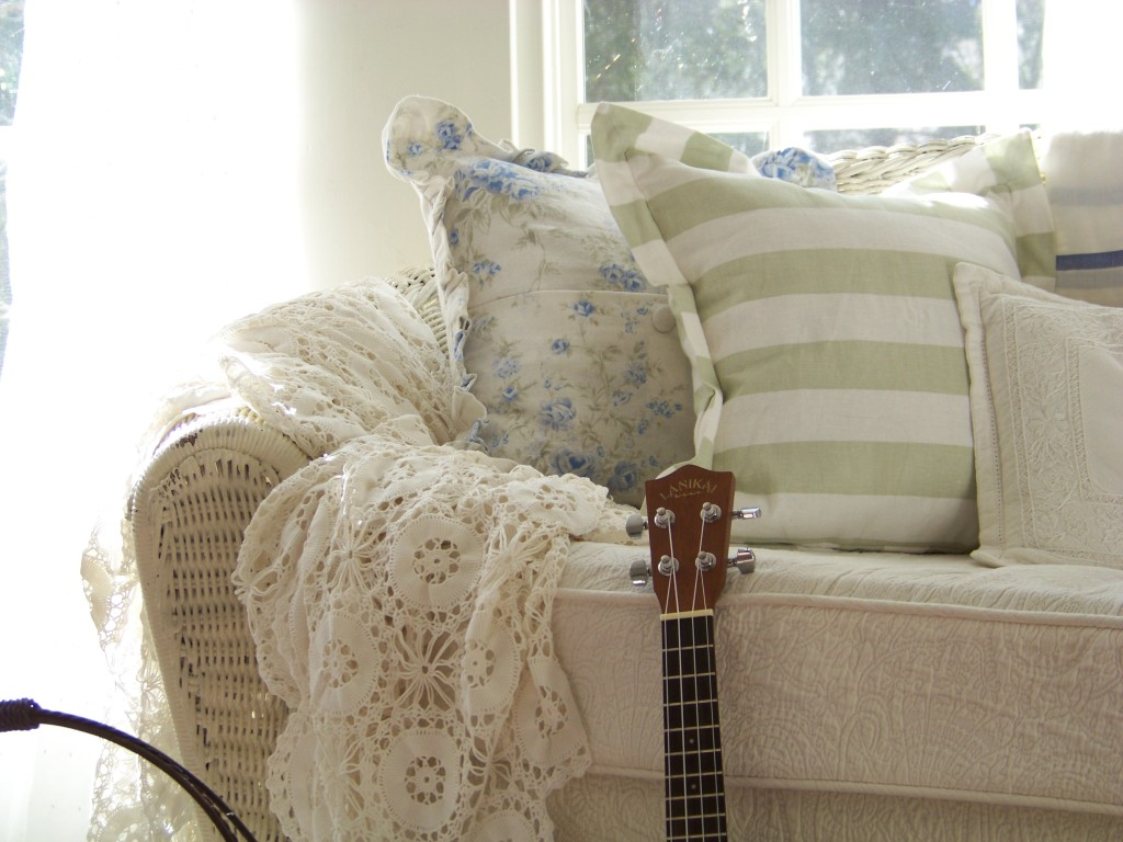 Cottage Fix- sun porch with shabby chic pillows and sun light