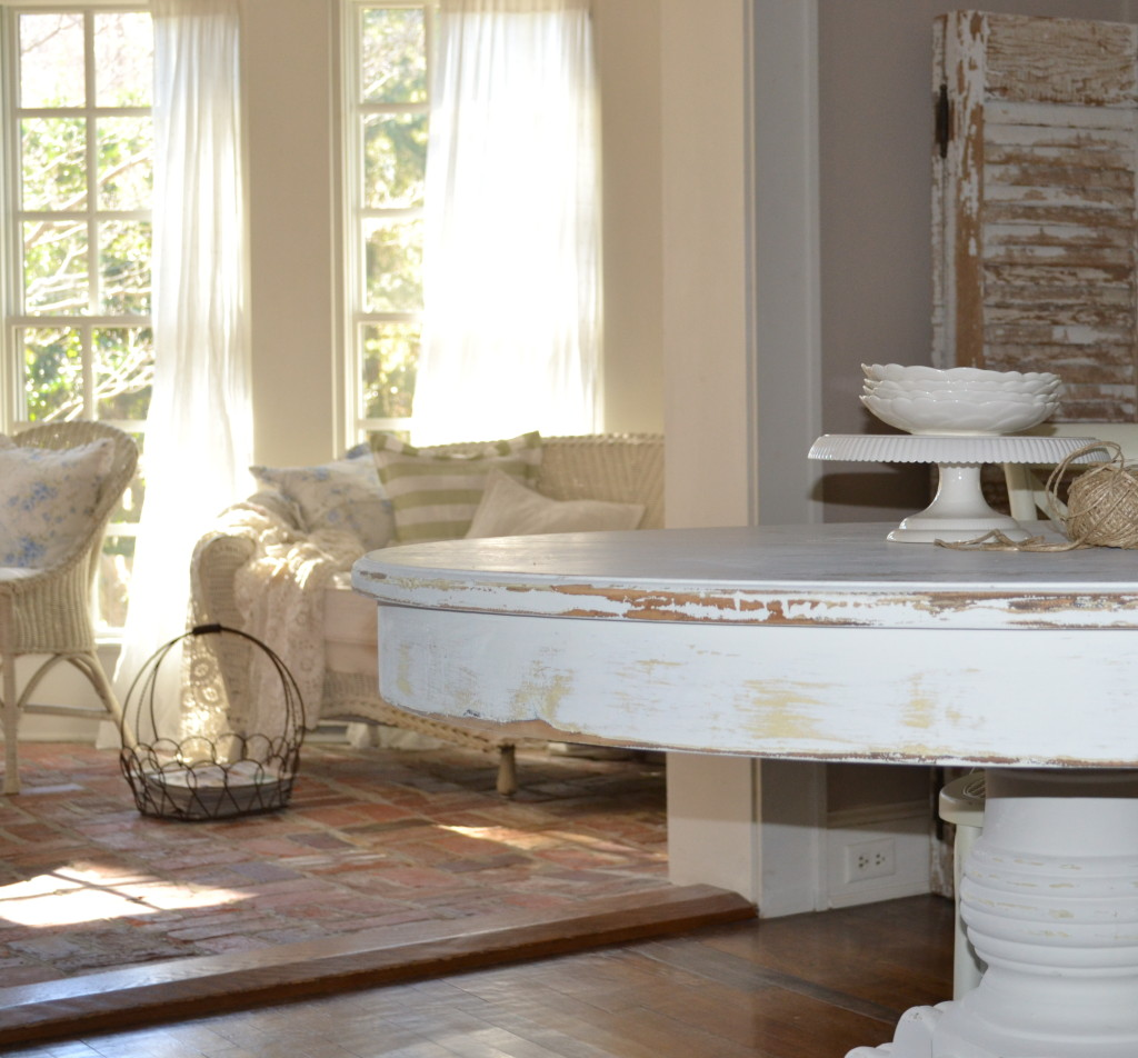 painted distressed table in creamy white