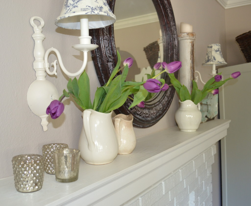 purple tulips on the mantle