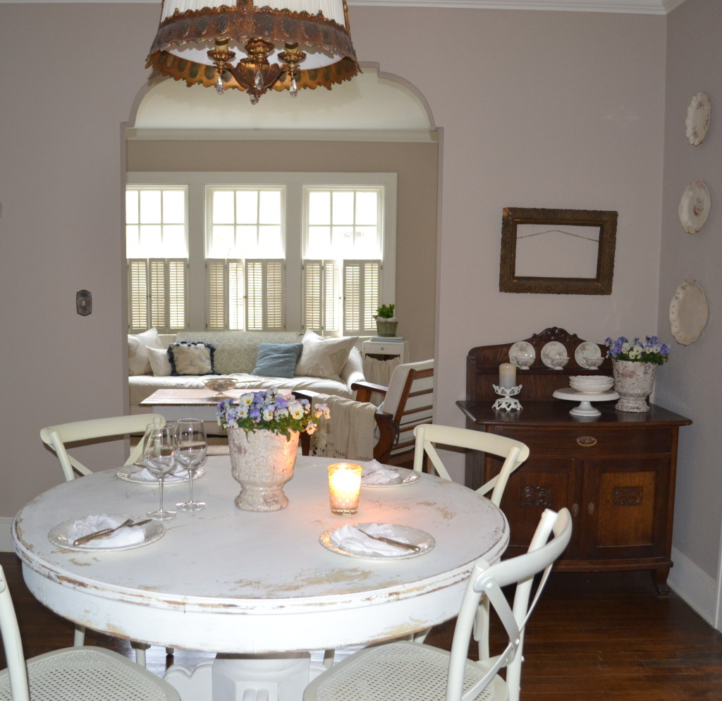 cottage dining room with chippy clay pots