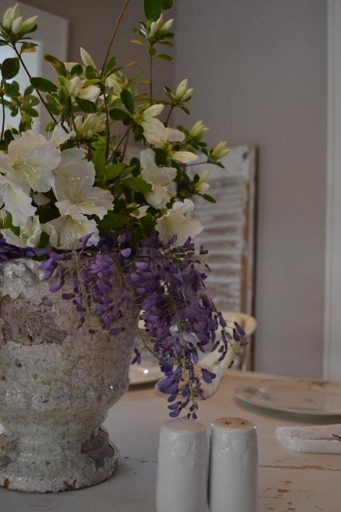 Spring centerpiece of white Azalea and Wisteria