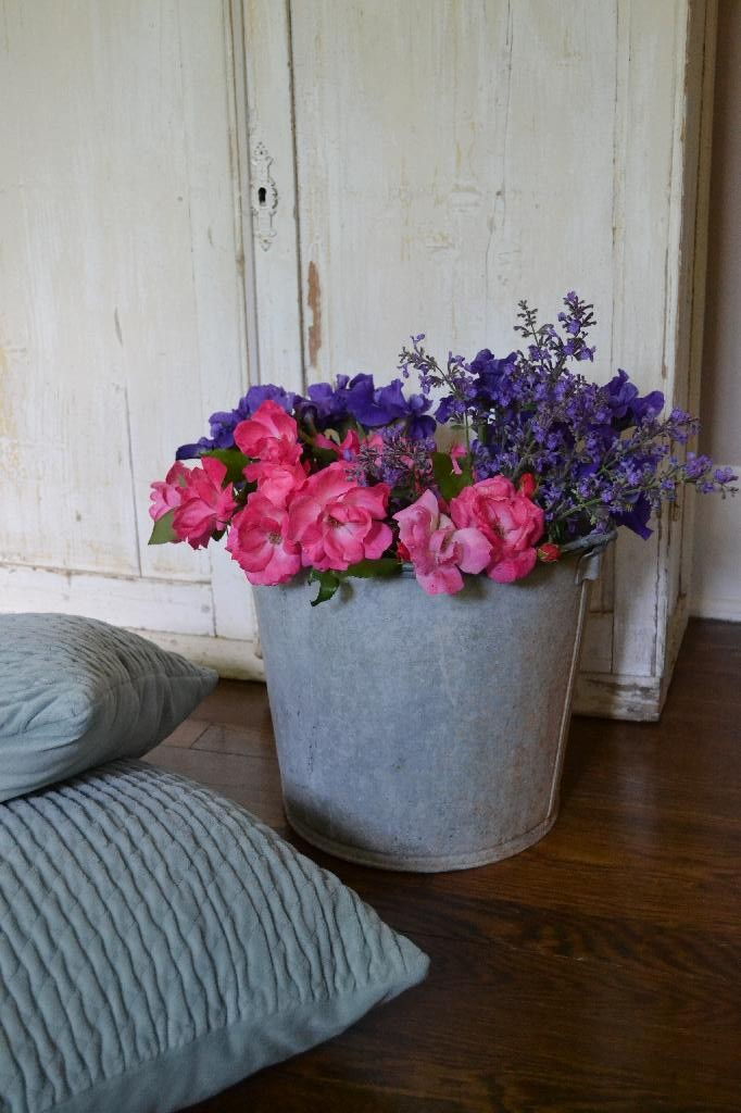 flowers and a galvanized bucket