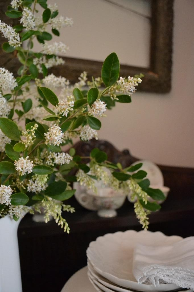 flowering branches on the dining room hutch