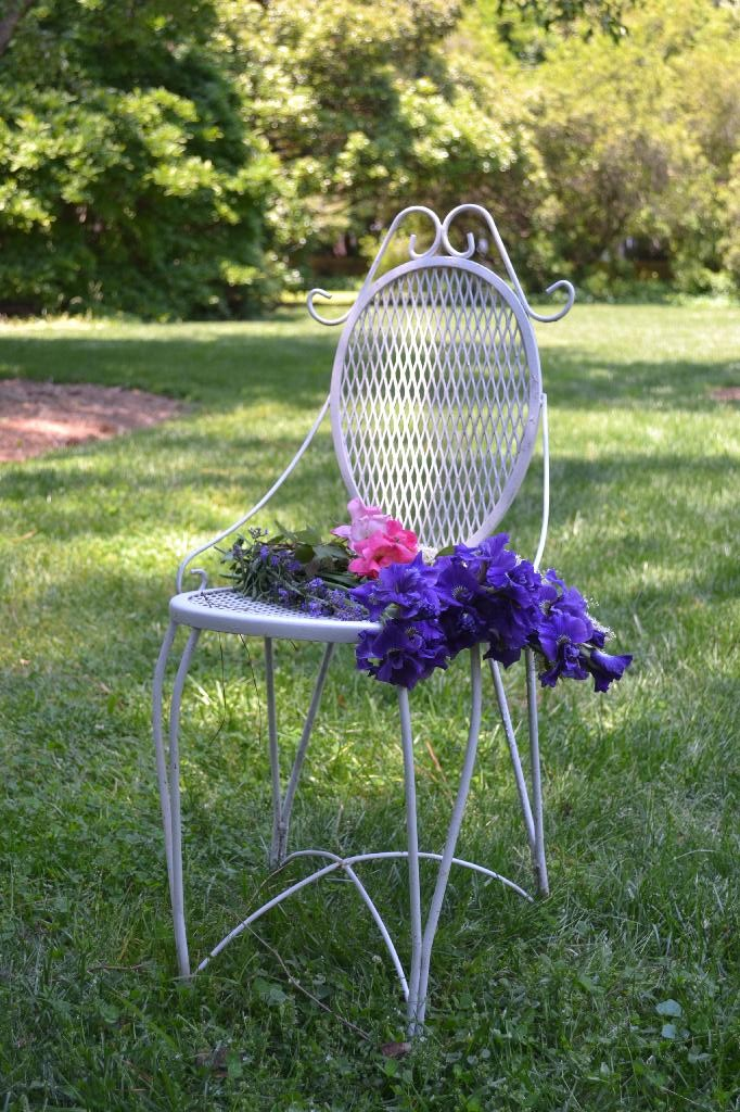 vintage chair in the garden with flowers