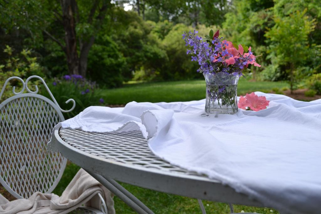 vintage garden table and chairs with flowers