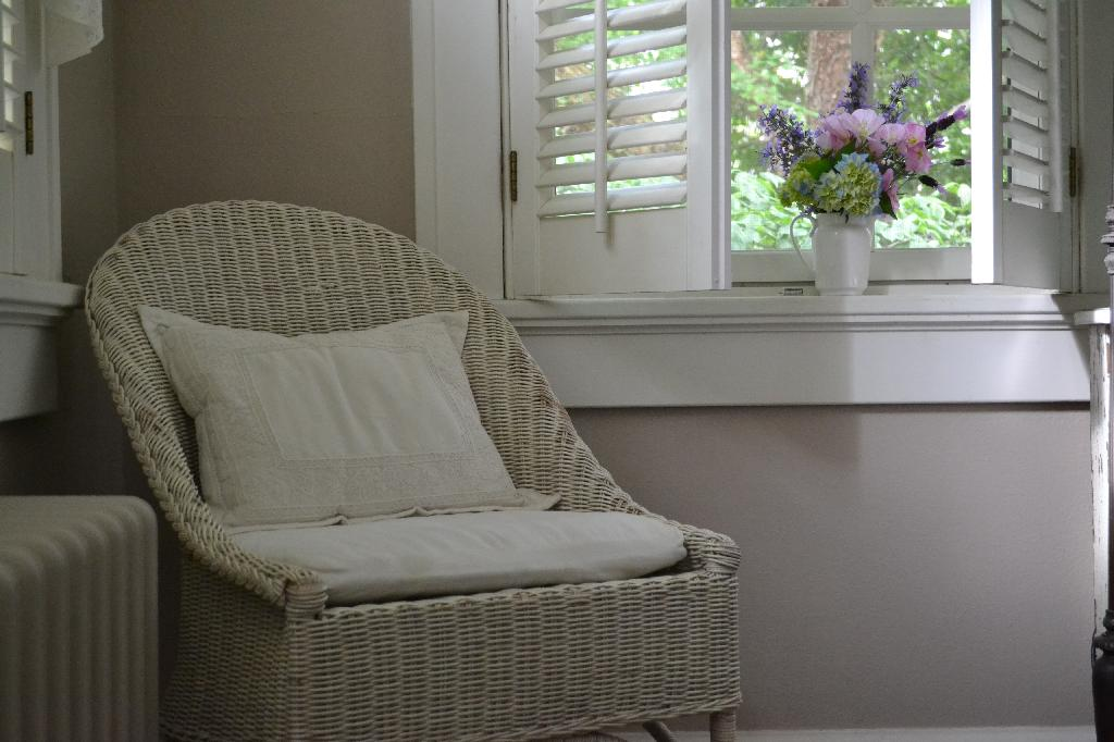 Cottage Fix - taupe home office, wicker chair, and garden flowers