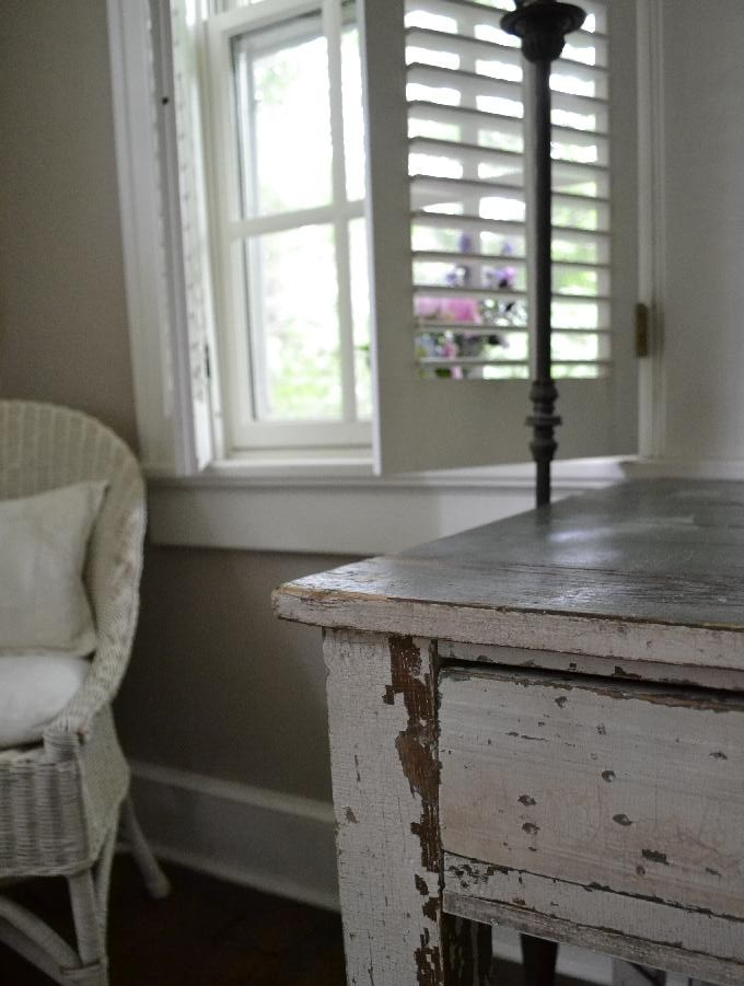 distressed farmhouse table used as a desk in our home office