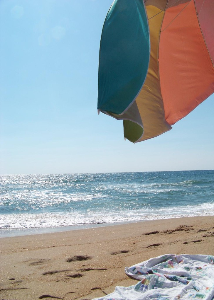 Cottage Fix -Cape Hatteras beach with a rainbow umbrella and cottage quilt