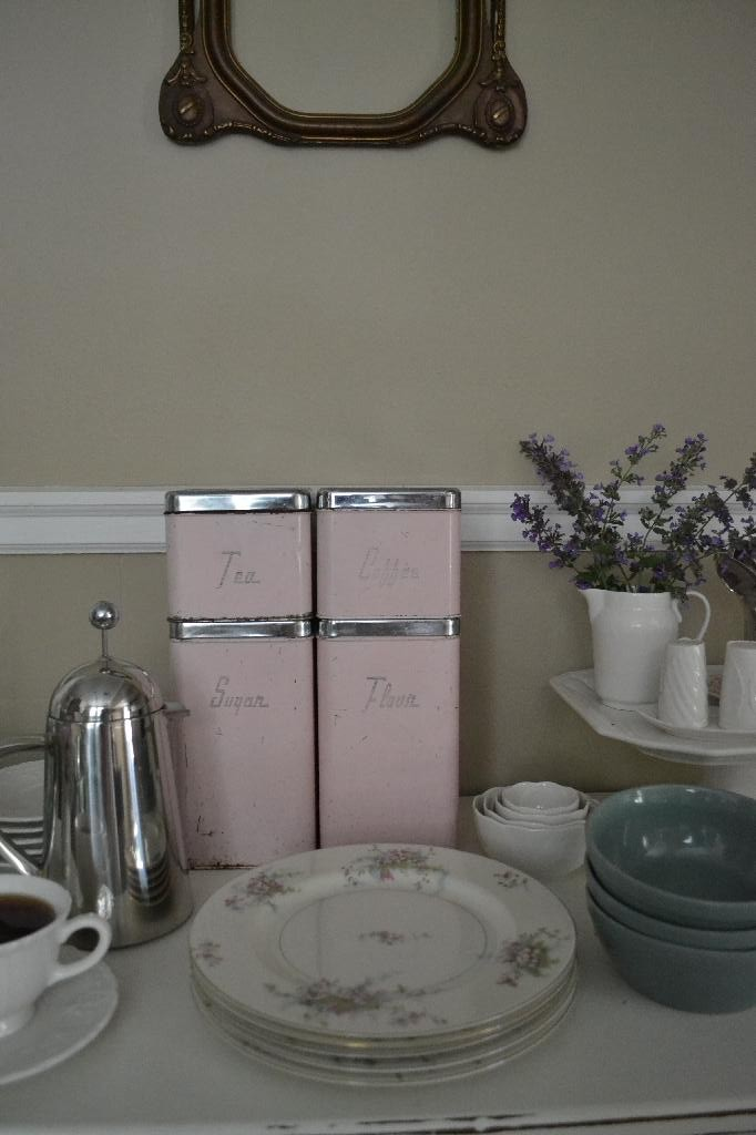 vintage canisters on the buffet