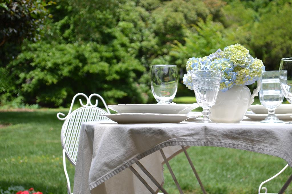 outdoor dining with a hydrangea centerpiece