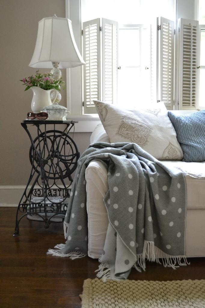cottage living room with a gray polka dot throw