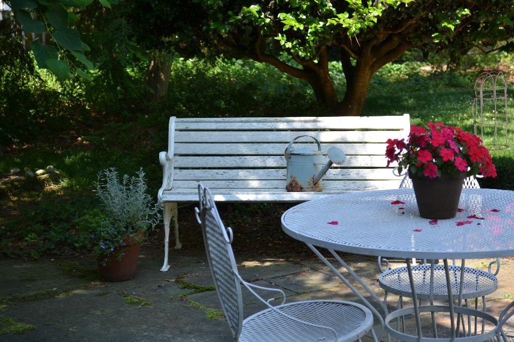 Cottage Fix -vintage white patio furniture and potted plants on the patio