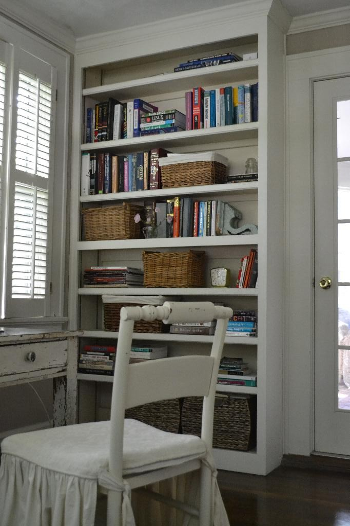 bookcase in our home office with baskets for storage