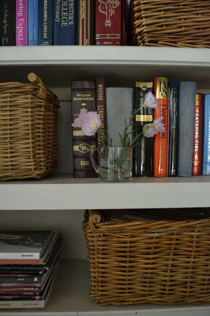 bookcase with baskets for storage