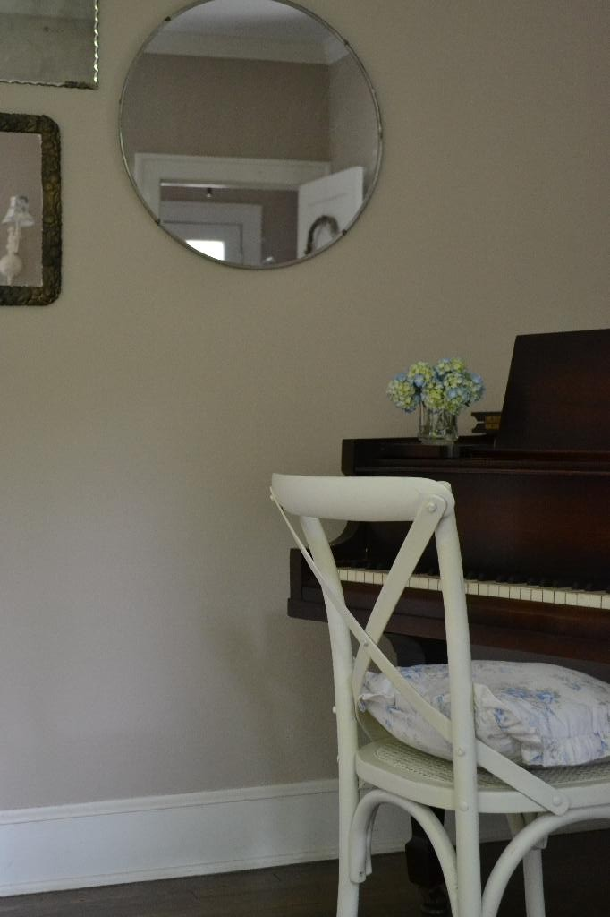 Cottage Fix -vintage mirror grouping behind the piano