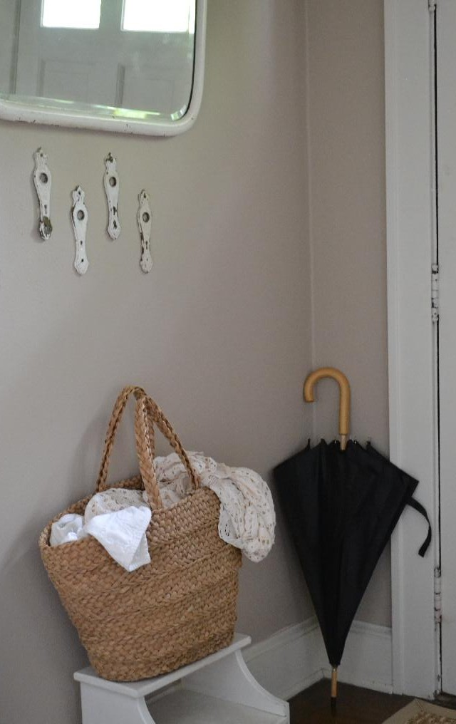 Cottage Fix -vintage mirror in the entry with umbrella and beach bag