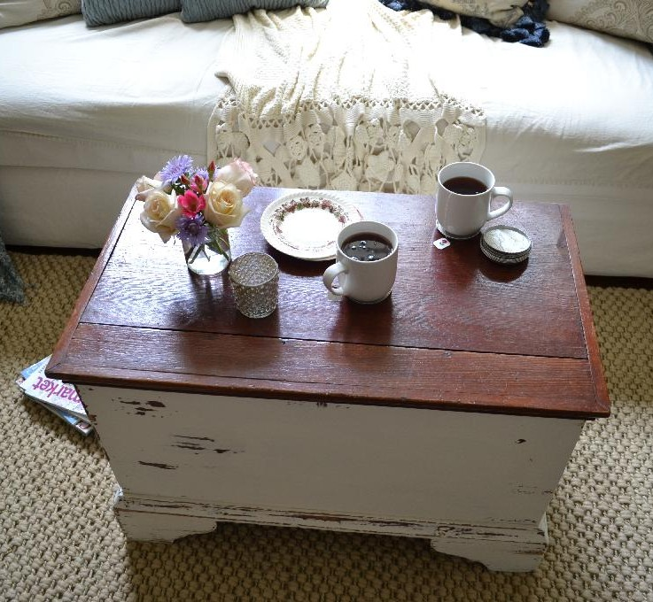 Cottage Fix - chippy white painted trunk with flowers and tea for two