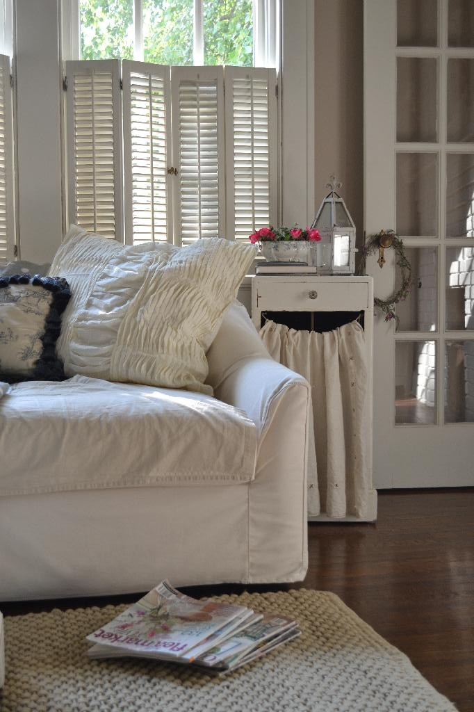Cottage Fix  - cream colored gathered shams on the sofa