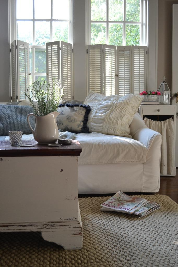 Cottage Fix - cream sofa and shams and white chippy trunk