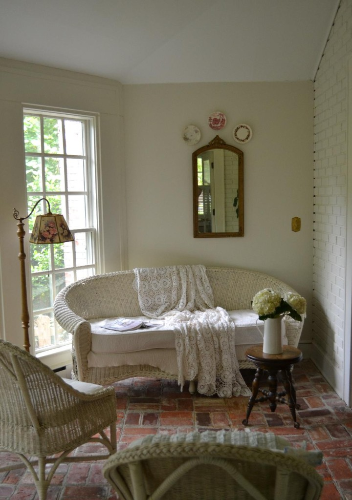 Cottage Fix - sun porch with white painted bricks and Parisian touches