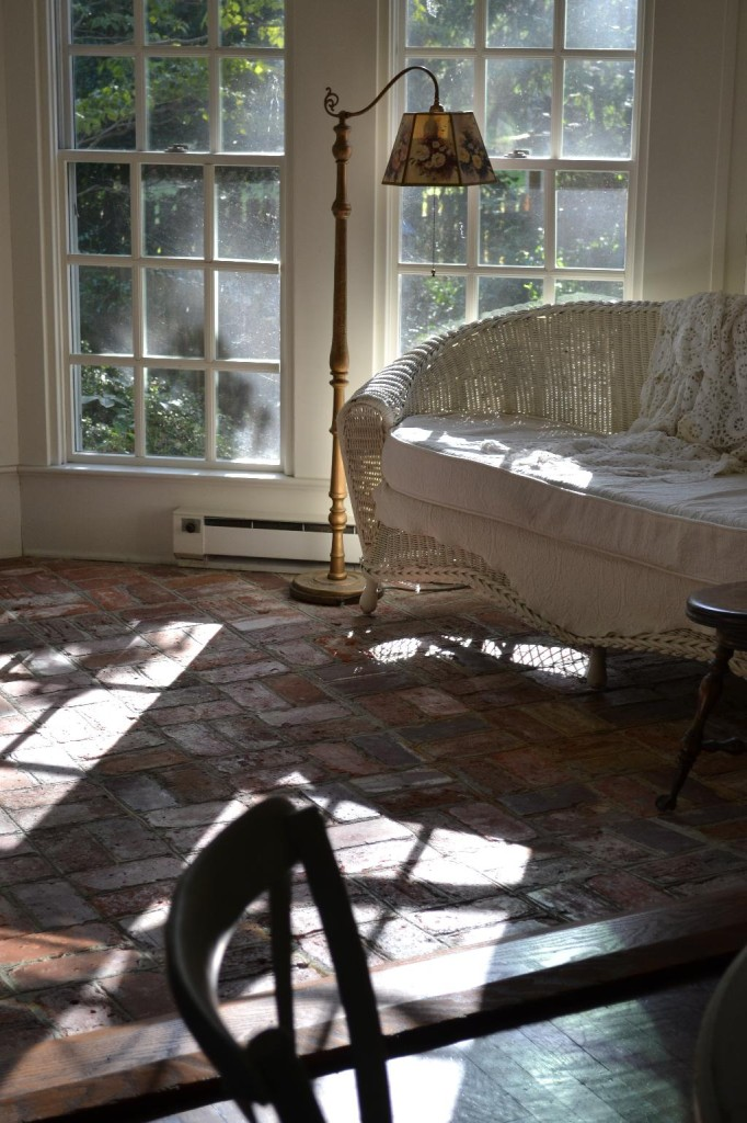 Cottage Fix - sun porch with light streaming in