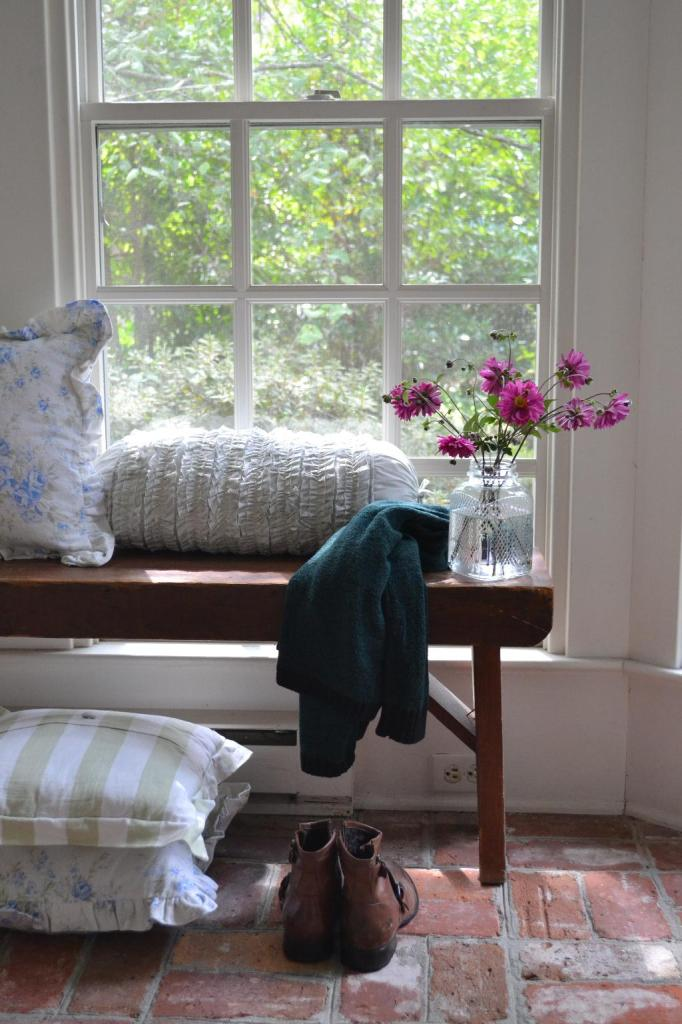Cottage Fix - rustic heirloom bench on the sun porch