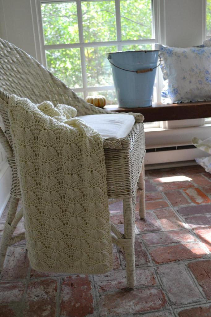 Cottage Fix - wicker chair with cozy ivory throw