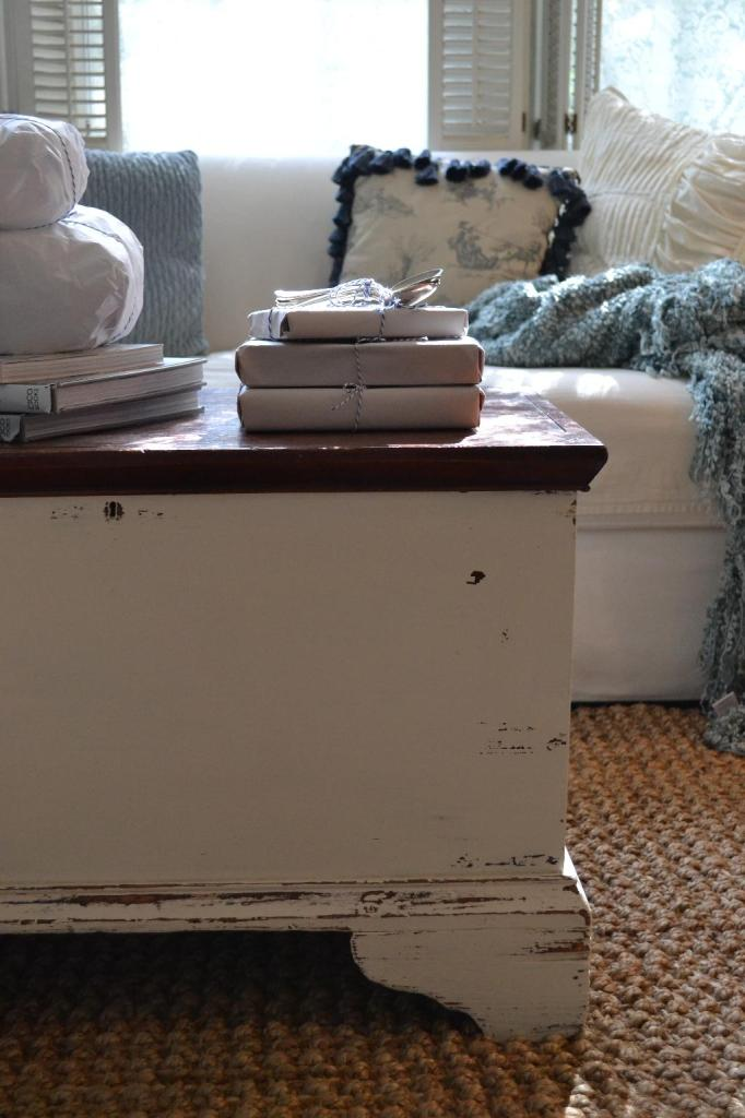 Cottage Fix - neatly wrapped books stacked on my trunk from Chateau Chic give-a-way
