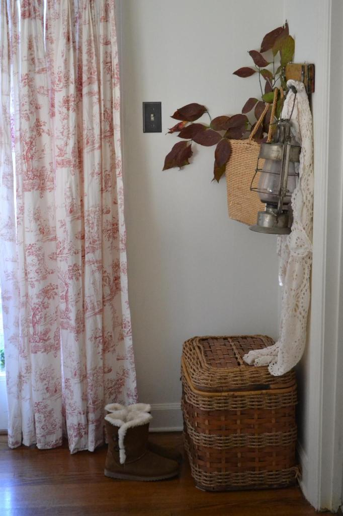 Cottage Fix - French toile drapery panels and a row of hooks
