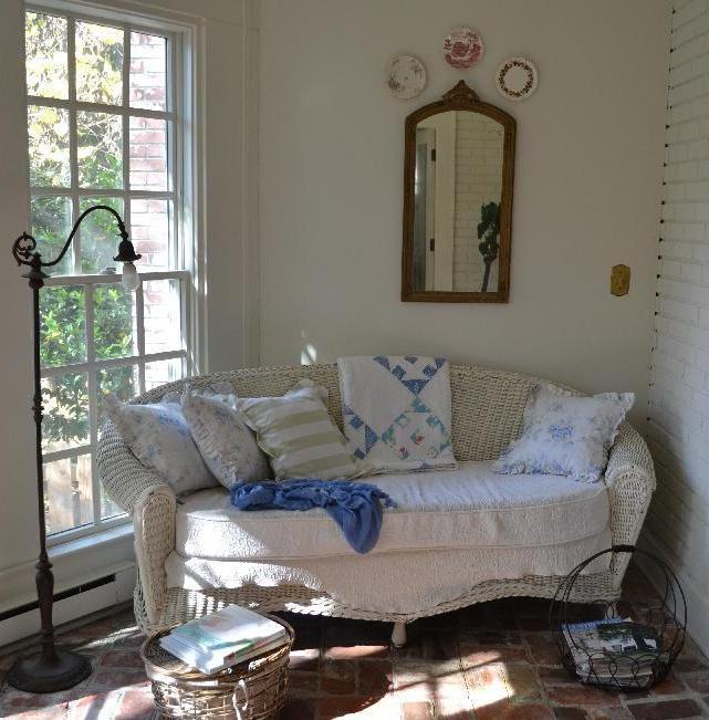 Cottage Fix - vintage quilt on the cottage sun porch