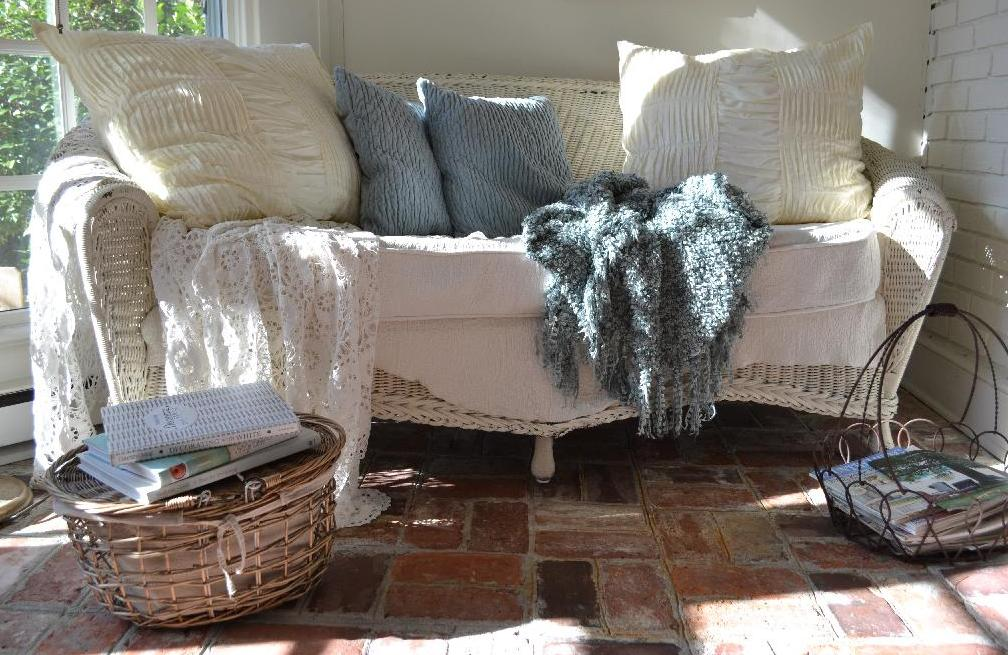 Cottage Fix - wicker settee with soft blue pillows and throw