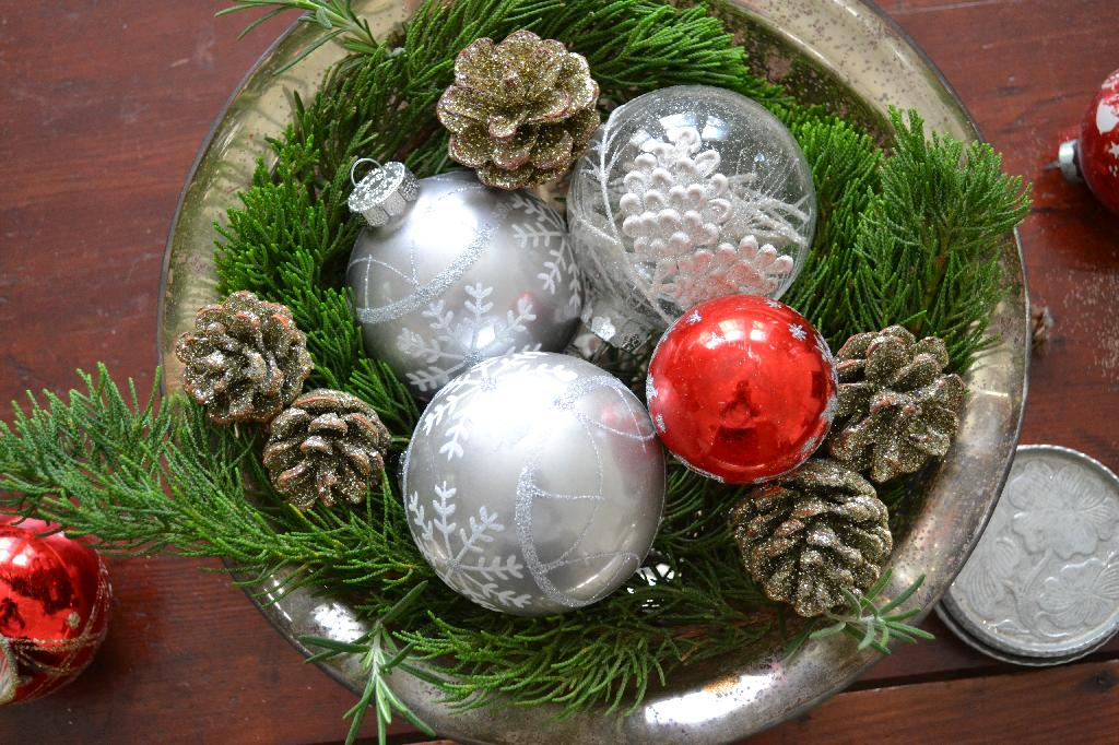 Cottage Fix - silver bowl with a mix of vintage and new ornaments with fresh greenery from the garden