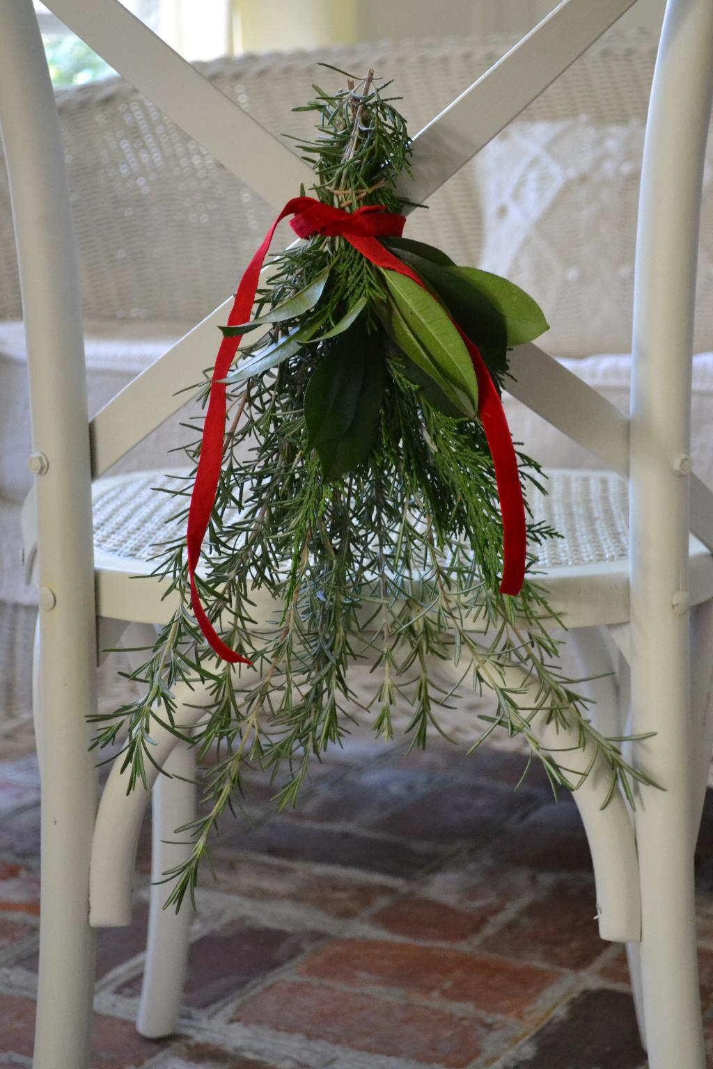 Cottage Fix - Christmas chair swag made of fresh greenery from the garden