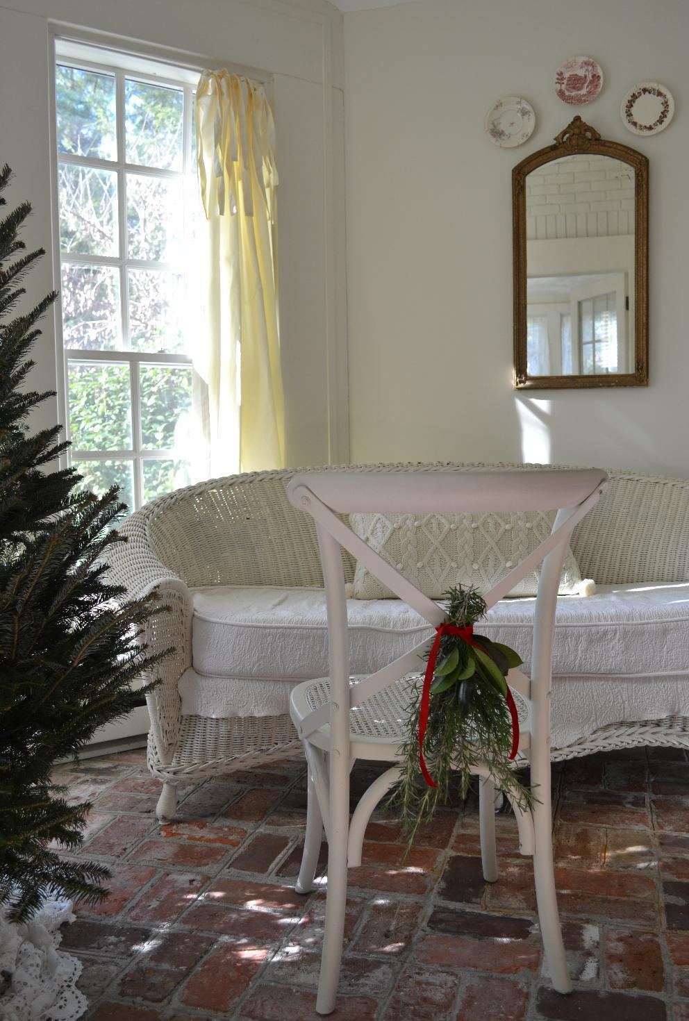 Cottage Fix - Christmas on the sun porch with a fresh greenery chair swag