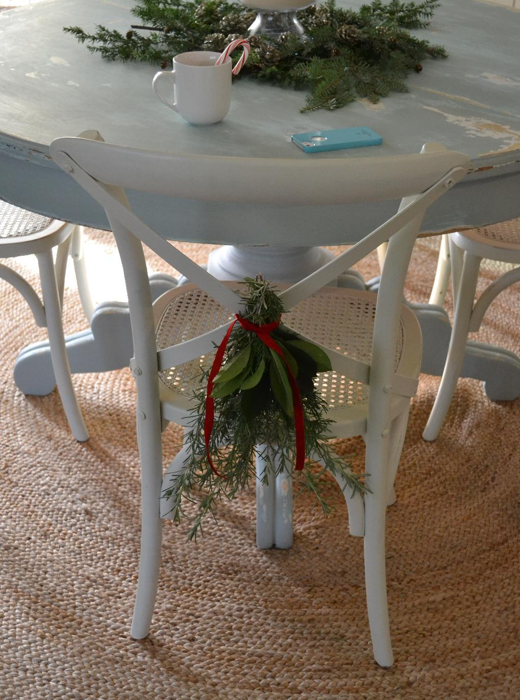 Cottage Fix - fresh greenery Christmas swag on the dining room chair