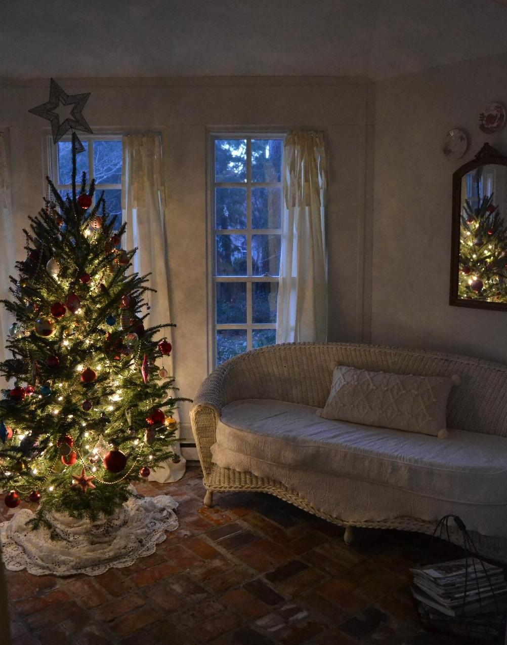 Cottage Fix - the Christmas tree lit up at dusk