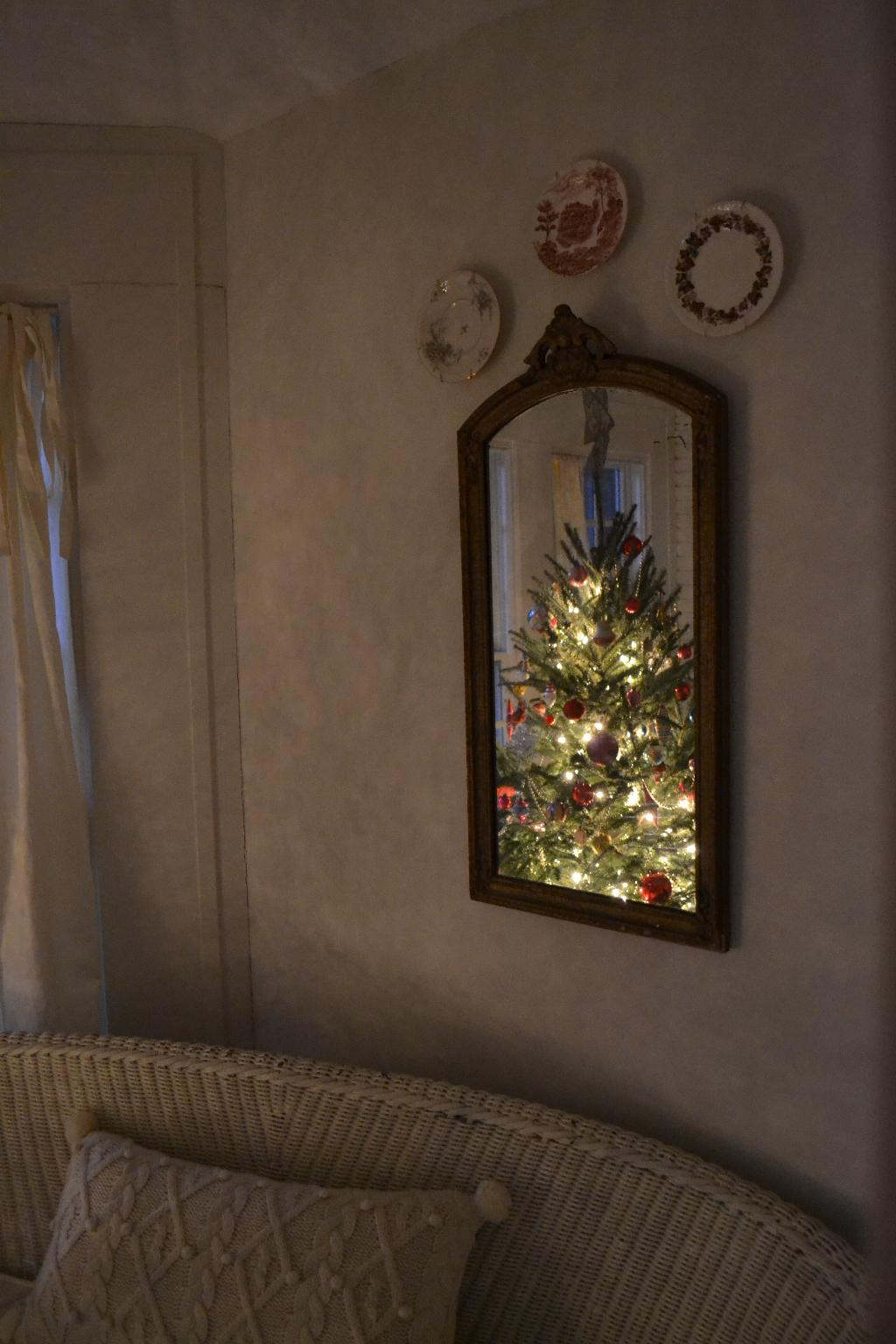 Cottage Fix - Christmas tree glowing in the mirror