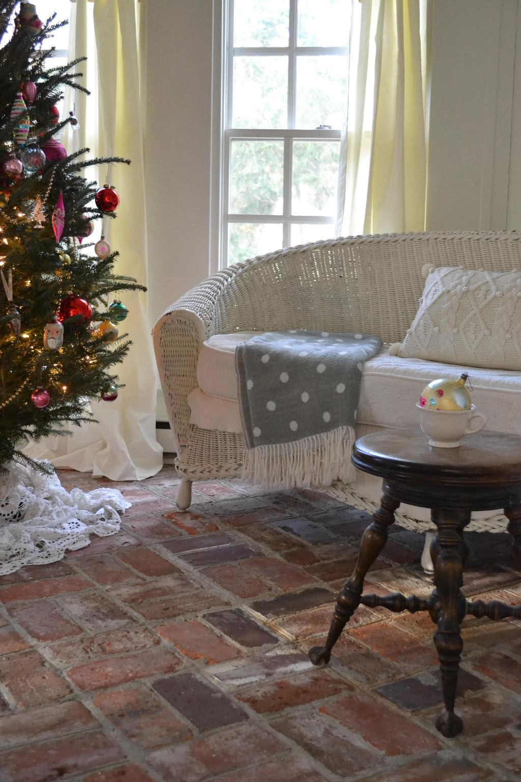 Cottage Fix - cottage sun porch with Christmas tree and polka do throw