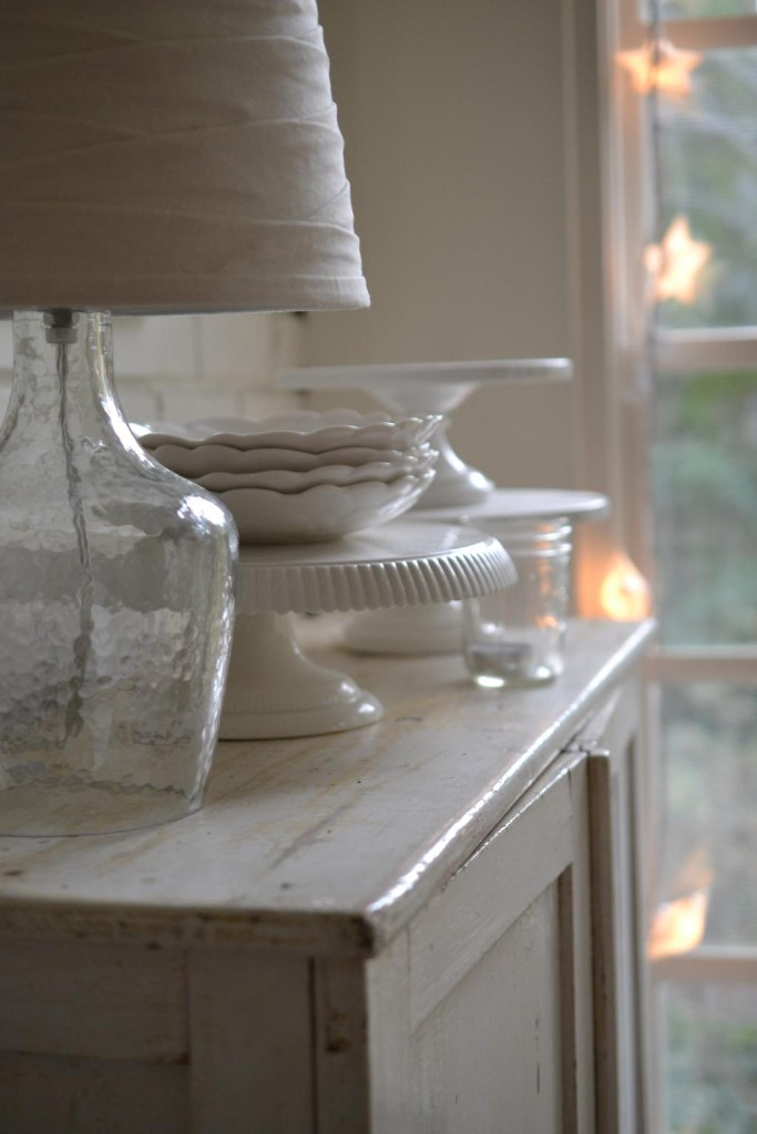 Cottage Fix blog - glass lamp, white cake plates, and star lights