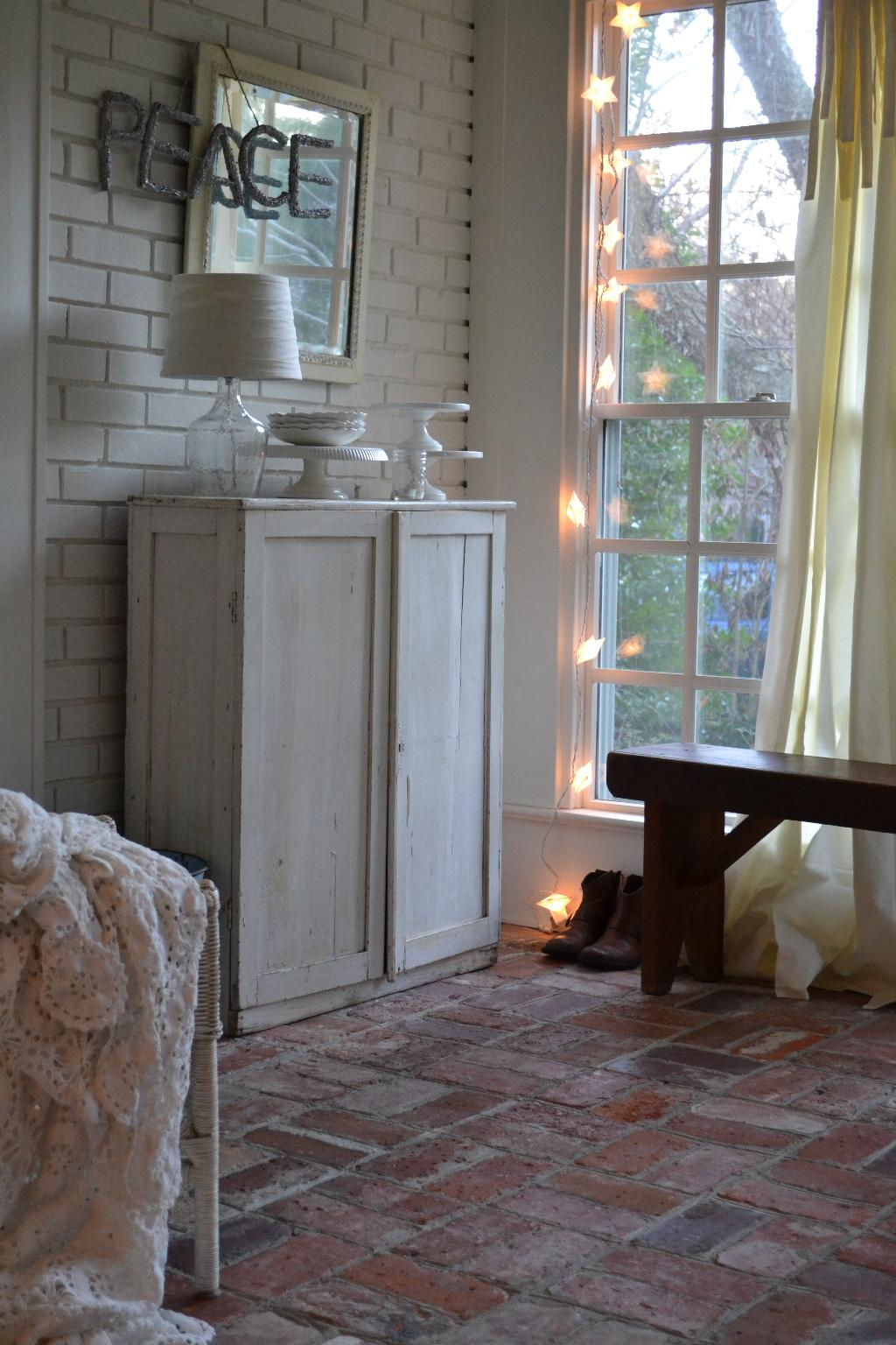 Cottage Fix - sun porch with whites and twinkly star lights