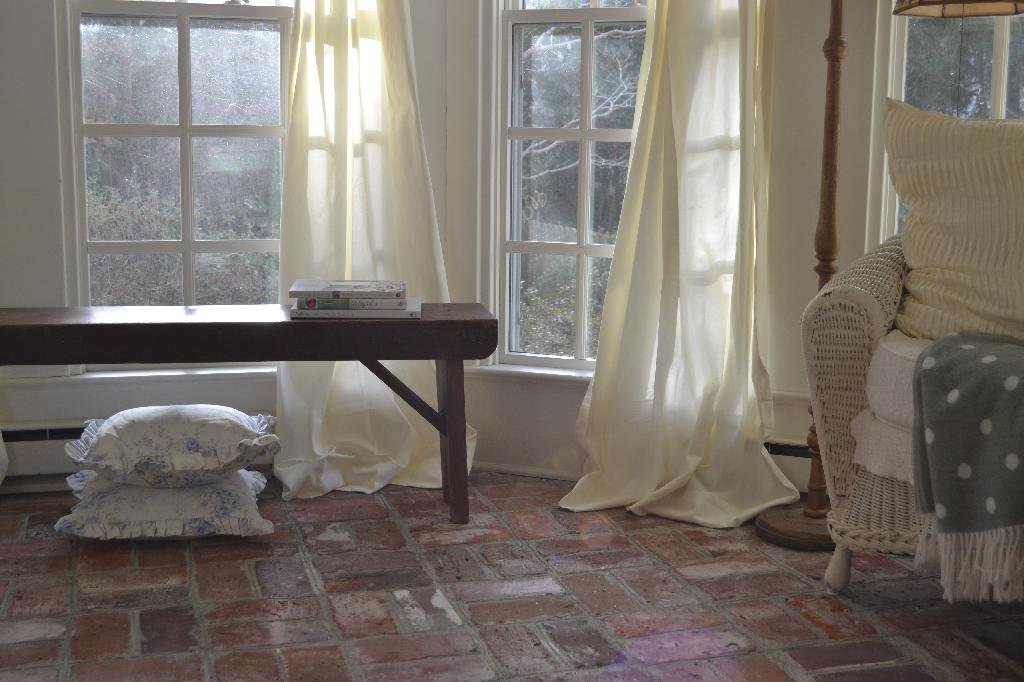 Cottage Fix - ivory drapes and vintage bench
