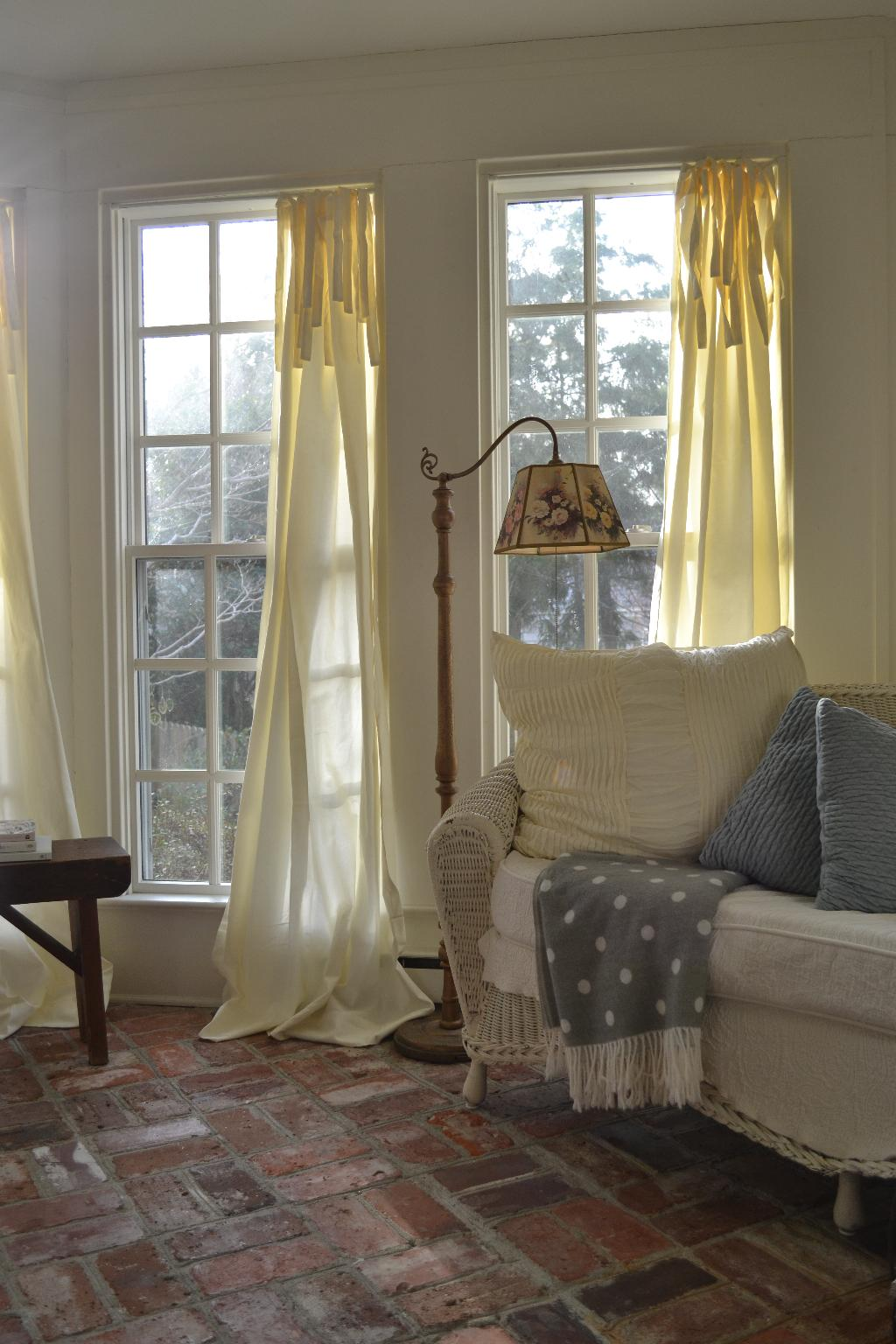 Cottage Fix - ivory drapes in the sun porch