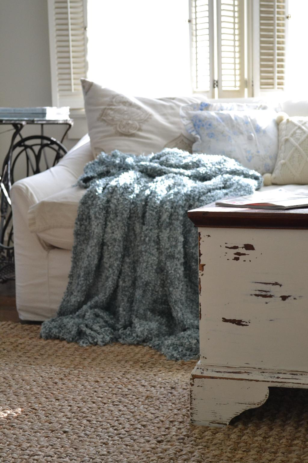 Cottage Fix - natural fiber rug, chippy paint trunk, and white sofa