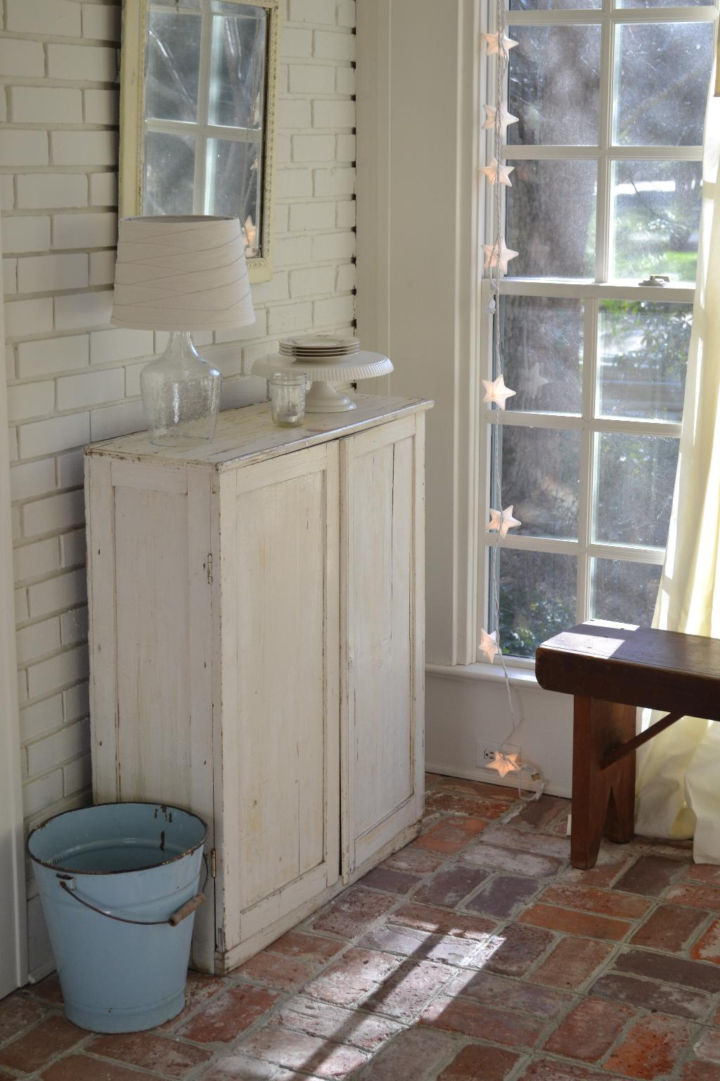 Cottage Fix - sun porch with glass lamp on a shabby cabinet