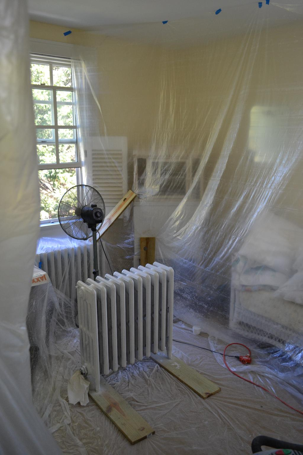 Cottage Fix - plastic tent to spraypaint a radiator inside