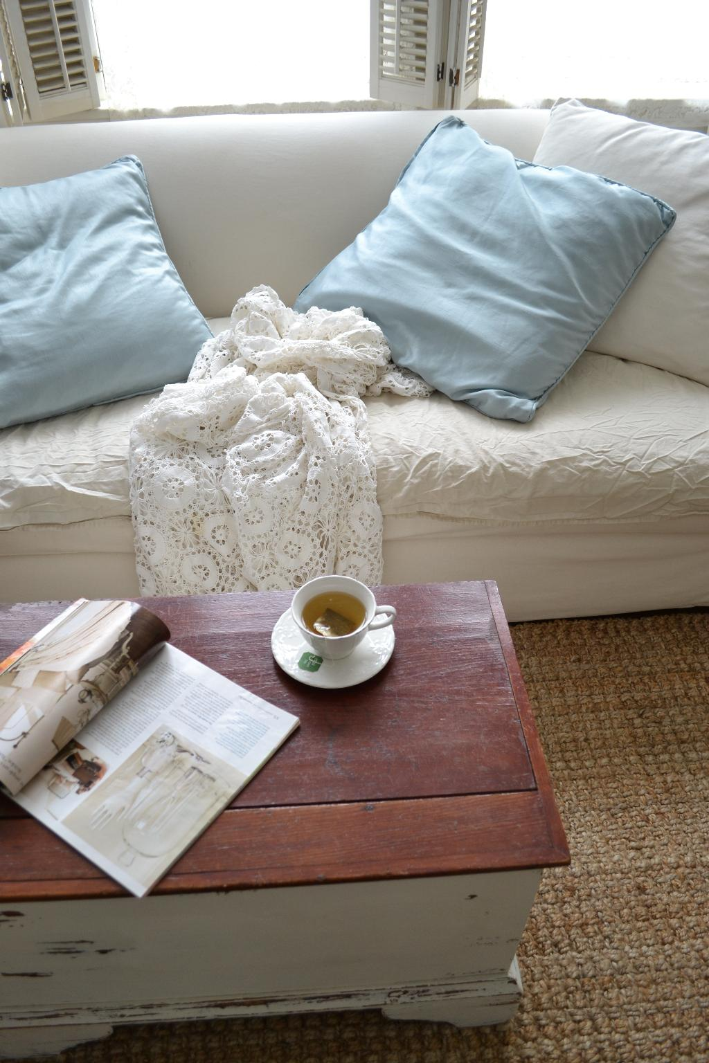 Cottage Fix - blue shimmery pillows, crochet, and white sofa