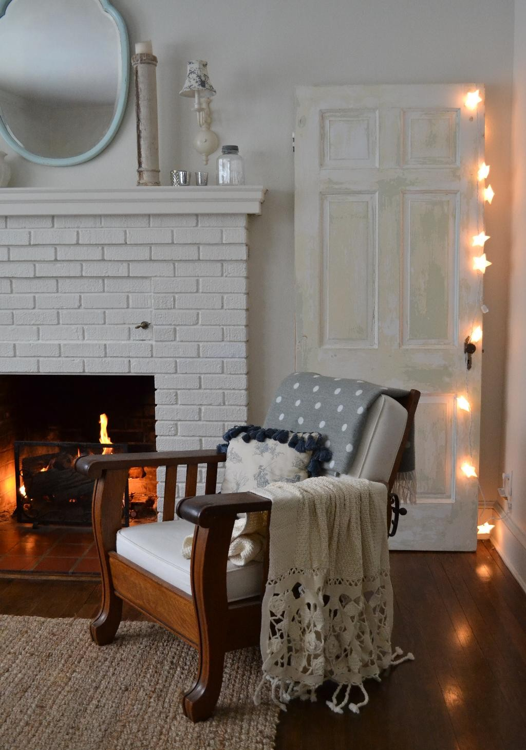 Cottage Fix - living room with chippy paint door and starry twinkle lights
