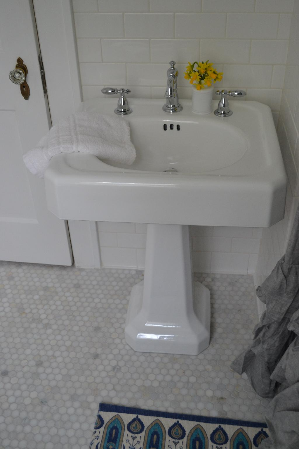 Cottage Fix - refinished vintage sink, Delta faucet, and marble hex floor tiles